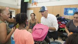 Assemblymember McCarty passes out backpacks
