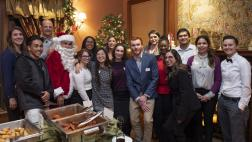 Assemblymember Kevin McCarty, Staff, and attendees with Santa